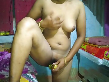 sexy Indian aunty naked in bedroom applying lotion to her big boobs